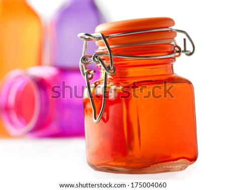 Multicolor orange purple glass jars  - stock photo