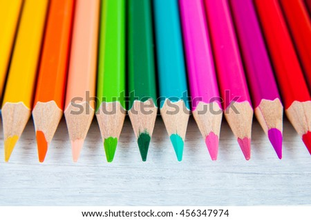 Multicolor pencils, on a wooden white background, close up - stock photo