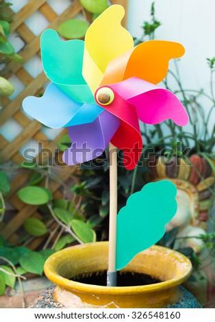 Multicolor Pinwheel Toy in garden - stock photo