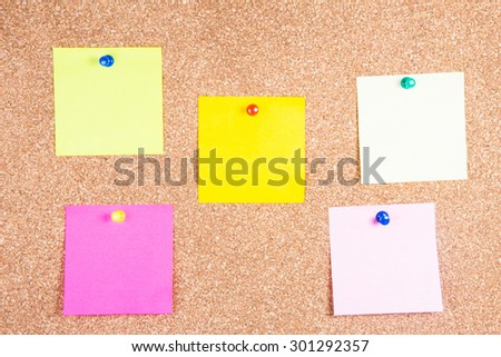 multicolor reminder sticky notes on cork board, empty space for text