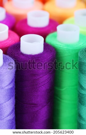 Multicolor sewing threads background - stock photo