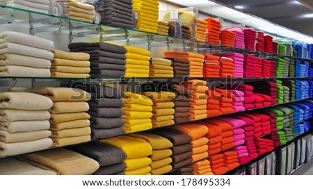 Multicolor towels in the shop - stock photo