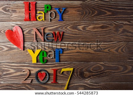 Multicolor wood inscription Happy New Year close up. Greeting card