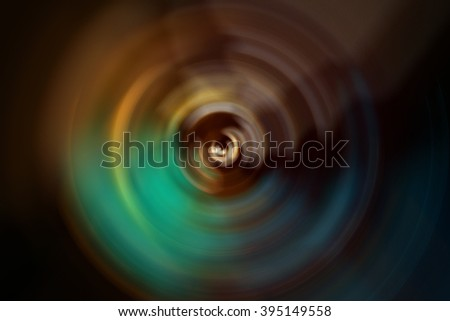 Multicolored abstract vortex gyrating with radial blur, like a moment of a cinematic transition, as in a flashback or movement to another dimension - stock photo