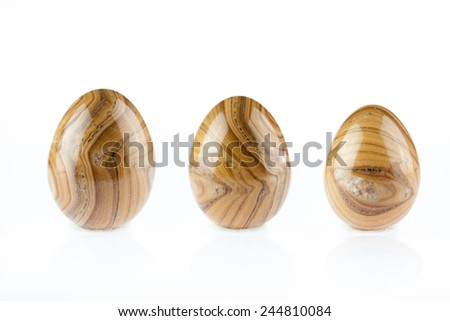 multicolored Agate stones egg shape on white background - stock photo