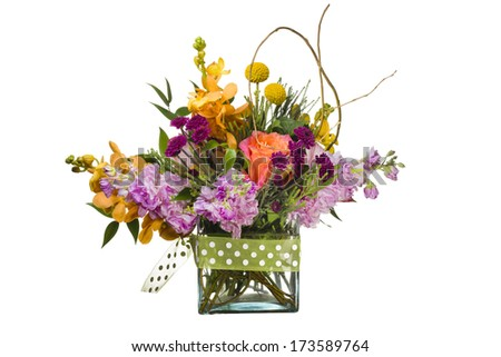 Multicolored arrangement of flowers in a clear glass vase isolated on a white background - stock photo