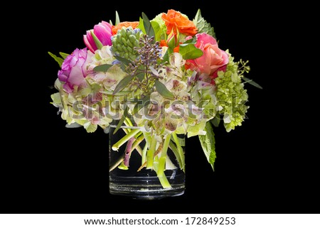 Multicolored arrangement of flowers isolated on a black background