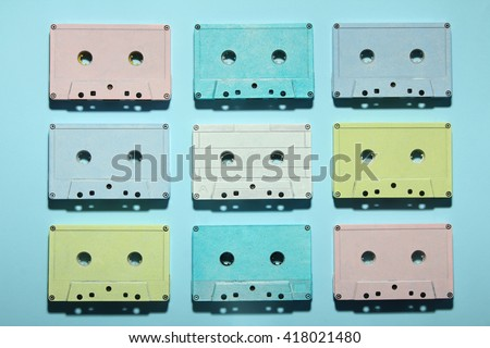 multicolored audio tapes on a blue background