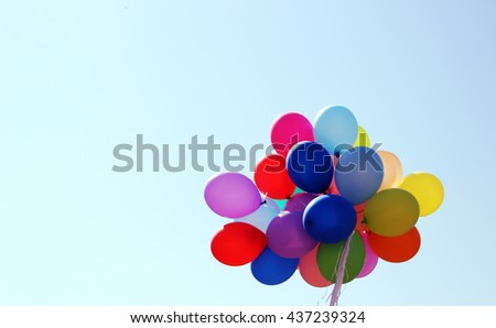 multicolored balloons against the blue sky - stock photo