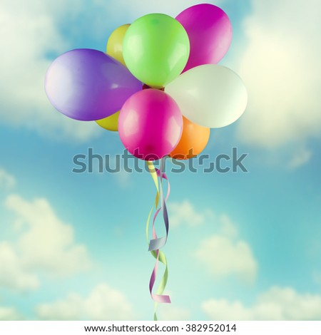 Multicolored balloons on the sky. - stock photo