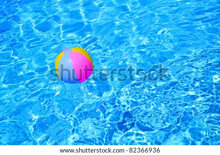 Multicolored Beach ball in swimming pool