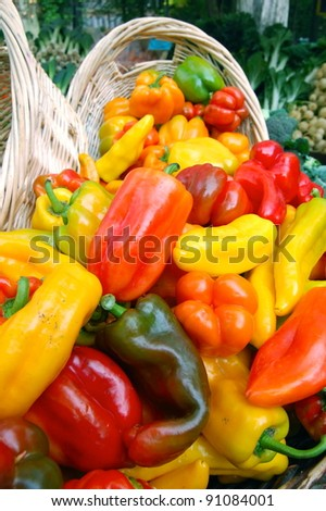 Multicolored Bell Peppers on Display at Farmers Market - stock photo