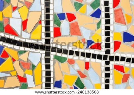 Multicolored broken mosaic tiles - stock photo