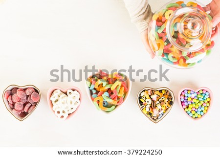 Multicolored candies on a white table. - stock photo