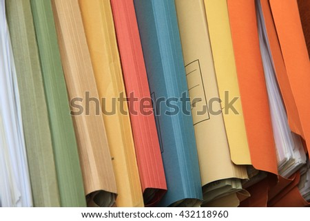 Multicolored cardboard office files - stock photo