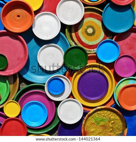 Multicolored ceramic plates - stock photo