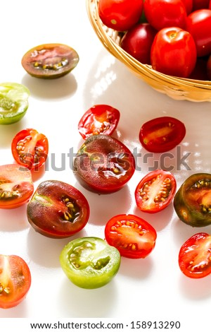 Multicolored cherry tomatoes picked from organic garden. - stock photo