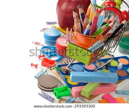 Multicolored children's school supplies on a white background