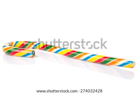 Multicolored Christmas candy cane over white background