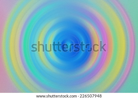 Multicolored circular blurry textured pattern/background in blue, green, pink and yellow