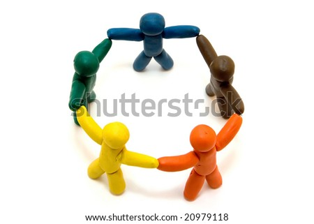 Multicolored clay people standing in circle on white background - stock photo
