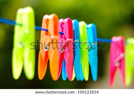 Multicolored clothes pin on rope - stock photo
