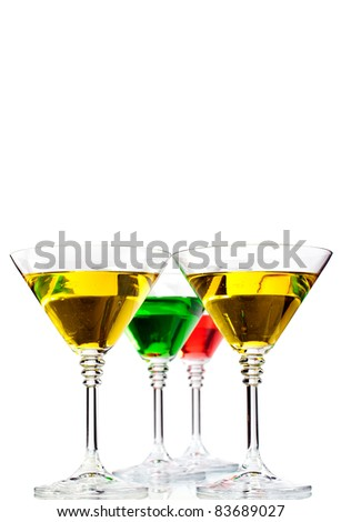 Multicolored cocktails served in classic martini glasses