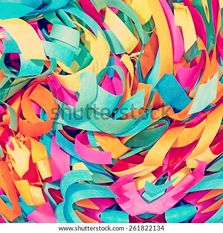 Multicolored confetti taken closeup abstract suitable as background. - stock photo