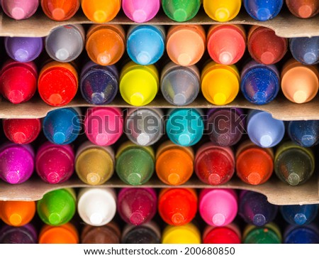 multicolored crayons tips organized in rows closeup - stock photo