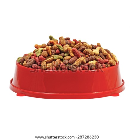Multicolored dry cat or dog food in red bowl isolated on white b - stock photo