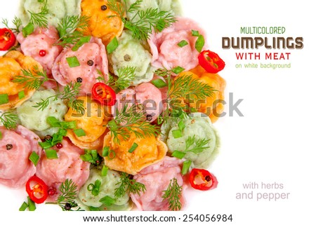 Multicolored dumplings with meat on a white background with herbs and pepper - stock photo