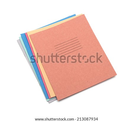 multicolored exercise books over the white background - stock photo