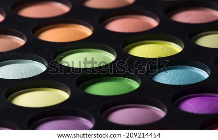 Multicolored eye shadows, close-up.