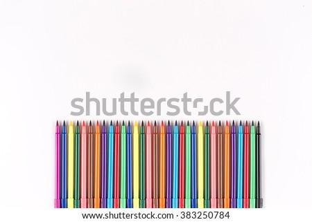 Multicolored felt pens isolated on white - stock photo