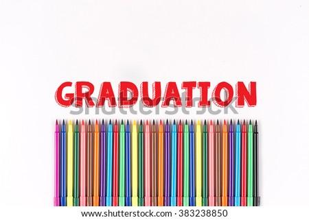 Multicolored felt pens isolated on white with GRADUATION word - stock photo