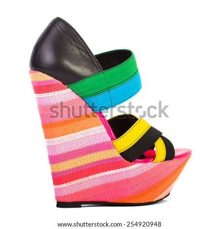 Multicolored female shoes on a platform isolated on white background - stock photo