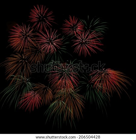 Multicolored fireworks isolated in dark background close up with the place for text, Malta fireworks festival, 4 of July, Independence day, New Year, explode, many fireworks, light show  - stock photo