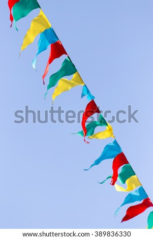 multicolored flags against the blue sky