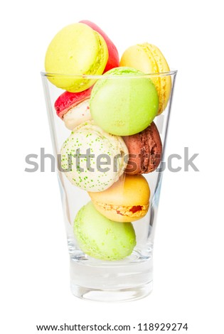 multicolored french macaroons in glass isolated on white background - stock photo