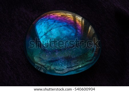 Multicolored glass on purple background.