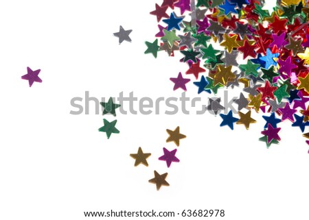 Multicolored glittering stars on a white background, Christmas decorations