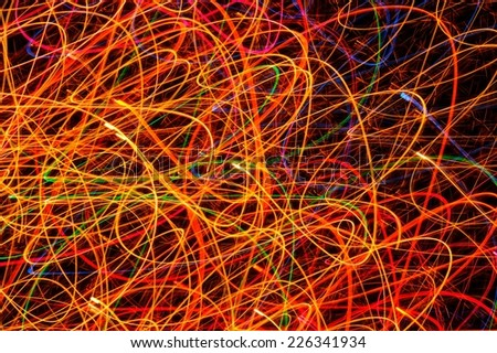 Multicolored Glowing Festive Lines as Background - stock photo