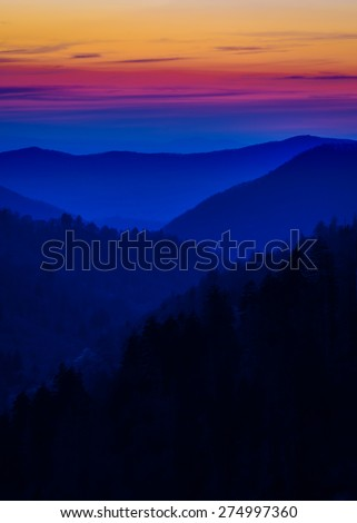 Multicolored layered mist depicted during a sunset in the Great Smoky Mountains - stock photo