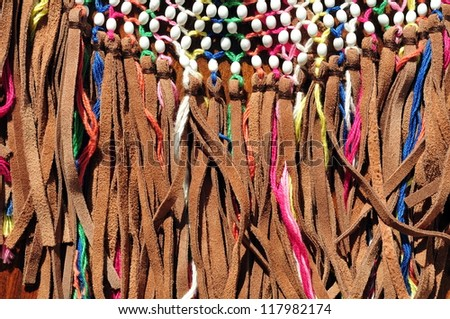 Multicolored leather fringe tassels - detail of a bag - stock photo