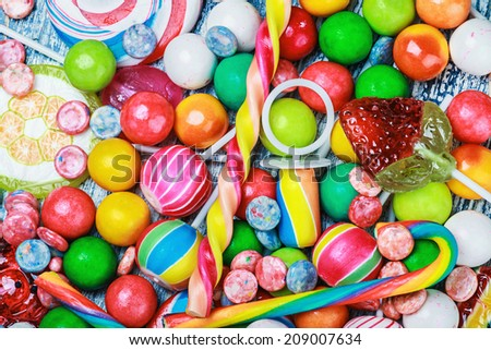 multicolored lollipop and chewing gum background - stock photo