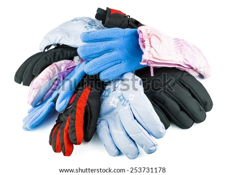 Multicolored mixed ski gloves varied in size isolated on white background - stock photo