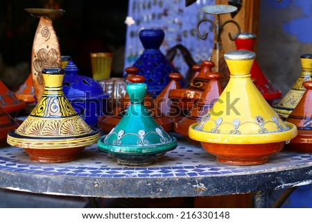Multicolored Moroccan tajines - traditional way of cooking Moroccan dishes.  - stock photo