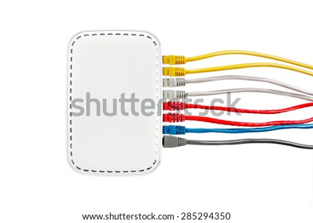 Multicolored network cables connected to router on a white background. Side view. Red, yellow, blue, gray and white Ethernet cables. White router on a white background. - stock photo