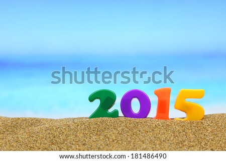 Multicolored new year 2015 on the beach - stock photo