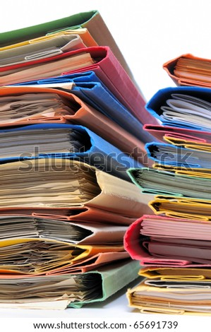 Multicolored office files with documents on white background - stock photo